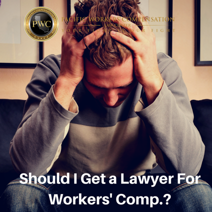 Should you get a lawyer for Workers' Comp? Image, injured worker with head in hands.