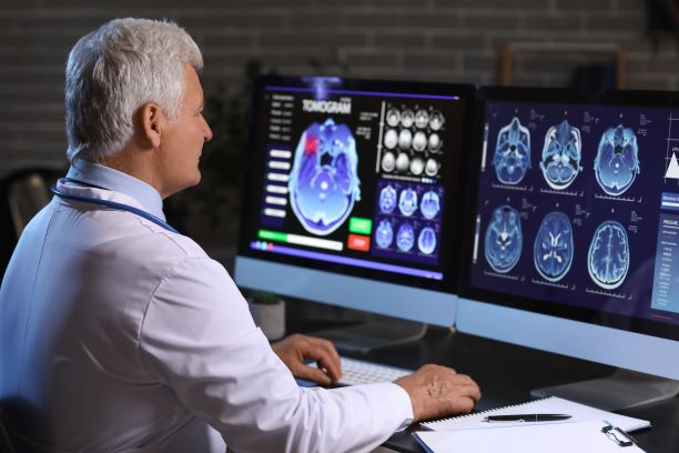 Neurologist evaluating brain scan of patient