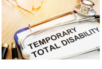 Temporary Total Disability Form on Clipboard